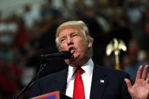 "Republican presidential nominee Donald Trump speaks to supporters Monday at a campaign rally in Asheville, North Carolina. Trump criticized Democratic rival Hillary Clinton for saying that half of his supporters belong in a ""basket of deplorables."""