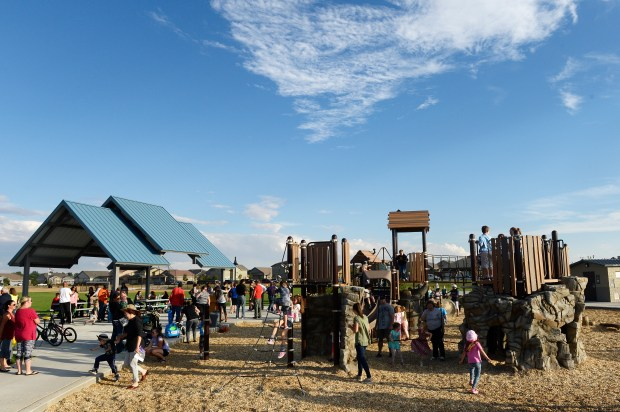 Families play at Villages East Park during a grand opening celebration on September 22, 2016, in Commerce City, Colorado. Villages East Park is the third park in a capital improvement program to open in Commerce City. (Photo by Anya Semenoff/The Denver Post)
