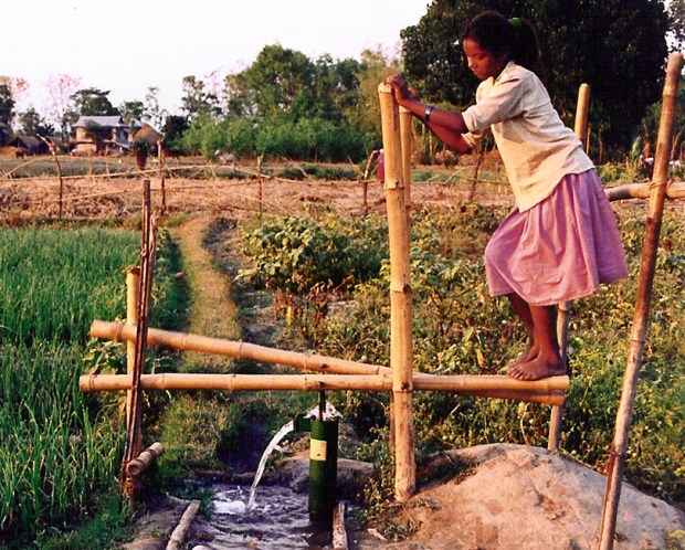 A woman in Cambodia uses a treadle pump that was provided by International Development Enterprises (IDE), which has pioneered pioneered low-cost farming technology for villagers in the poorest parts of the world. IDE is one of more than 200 organizations that are housed in Denver's Posner Center for International Development.