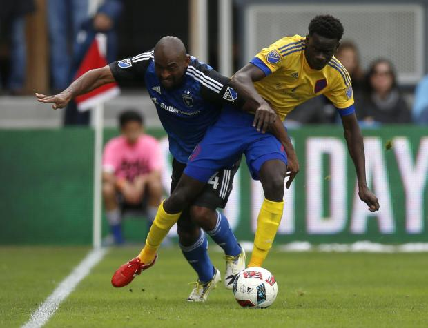 Earthquakes' Marvell Wynne (4) fights for the ball against Colorado Rapids' Dominique Badji (14)