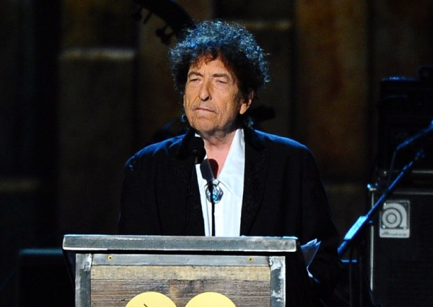 FILE - In this Feb. 6, 2015 file photo, Bob Dylan accepts the 2015 MusiCares Person of the Year award on Feb. 6, 2015. Dylan was awarded the Nobel Prize in literature on Thursday.