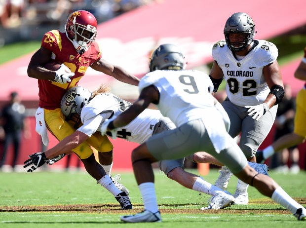 Justin Davis (22) of the USC Trojans is tackled