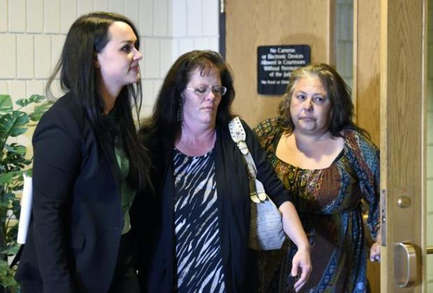 Elizabeth Burris, middle, walks out of a courtroom after her sentencing hearing on Oct. 4, 2016 at the Boulder County Justice Center.
