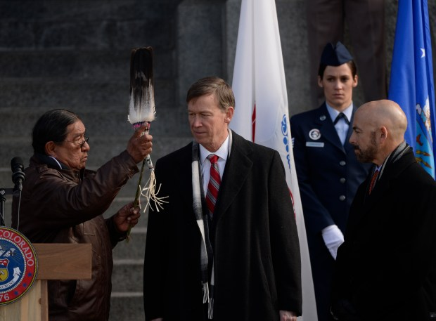 Ute Mountain tribe member, Terry Knight, gives a Native American blessing the Colorado Governor John Hickenlooper, center, and Lt. Gov. Joseph Garcia, during Gov. John Hickenlooper's inauguration ceremony at the Colorado State Capitol Jan. 13, 2015.