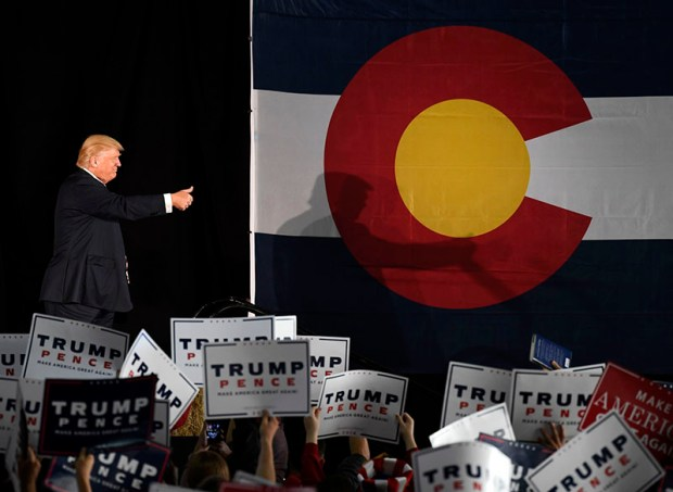 Republican presidential nominee Donald Trump gives a thumbs-up to supporters at a campaign rally in Colorado Springs on Tuesday.