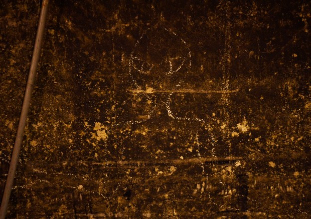 A image of an alien scribbled on a wall by an employee near the tunnels underneath Denver International Airport October 20, 2016.