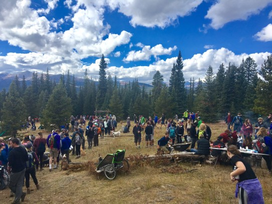 A photo of people waiting near Vance's Cabin for free beer.