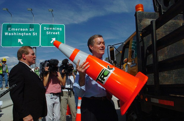 Gov. Bill Owens and others celebrate the completion of the T-REX project, which expanded Interstate 25 and added light rail, on Aug. 22, 2006.