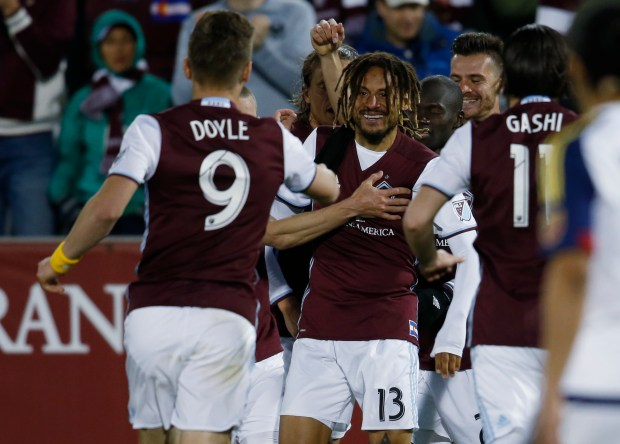 Colorado Rapids midfielder Jermaine Jones, center, is congratulated by forward Kevin Doyle,
