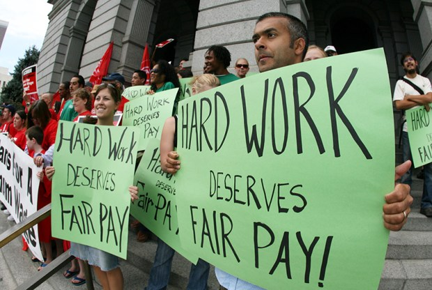Supporters of raising Colorado's minimum wage demonstrate at the state Capitol on Aug. 3, 2006. That year, voters, chose to increase the minimum wage from $5.15 an hour to $6.85 and adjust it annually to the Consumer Price Index. Amendment 70 on this year's state ballot would raise the minimum wage to $12 an hour by 2020.
