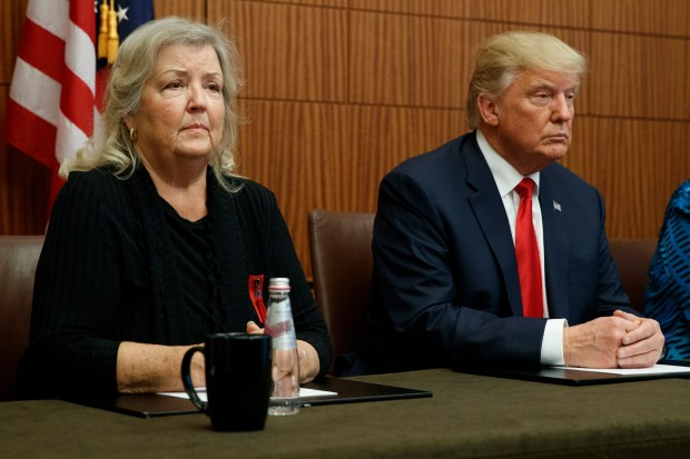Republican presidential candidate Donald Trump, right, listens as Juanita Broaddrick, who has accused former President Bill Clinton of sexual assault, speaks Sunday in St. Louis before the second presidential debate.