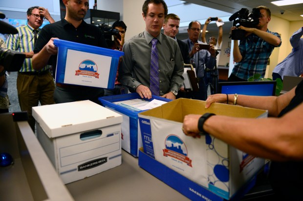 Marijuana activist Emmett Reistroffer and cannabis consultant Kayvan Khalatbari deliver signatures for a public cannabis use ballot initiative to the Denver election officials on Aug. 12. Initiative 300 would allow businesses in Denver to apply for permits to let customers bring and consume their own marijuana.