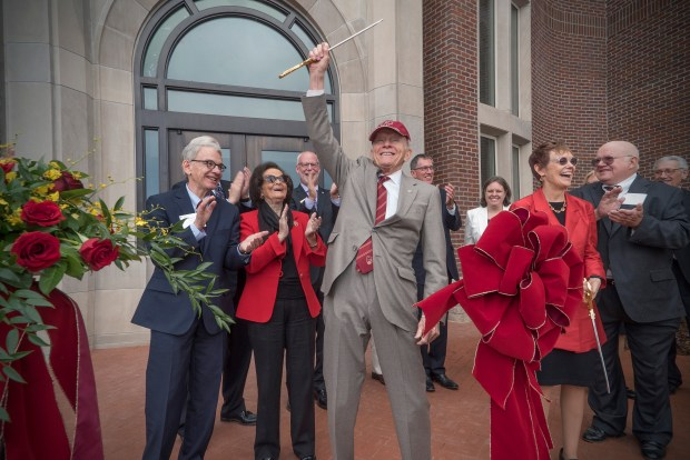 University of Denver Chancellor Emeritus Daniel Ritchie cuts the ribbon for the new Daniel Felix Ritchie School of Engineering and Computer Science on Oct. 14, 2016.