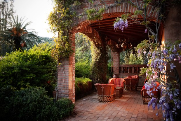 A lounge is situated among wisteria at a spa in Tecate, Baja California. MUST CREDIT: Photo by Rancho La Puerta.