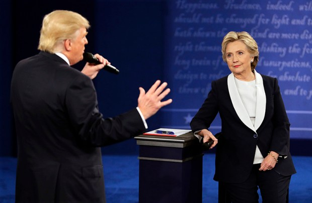 Republican presidential nominee Donald Trump and Democratic presidential nominee Hillary Clinton speak during Sunday night's town hall debate at Washington University in St Louis.