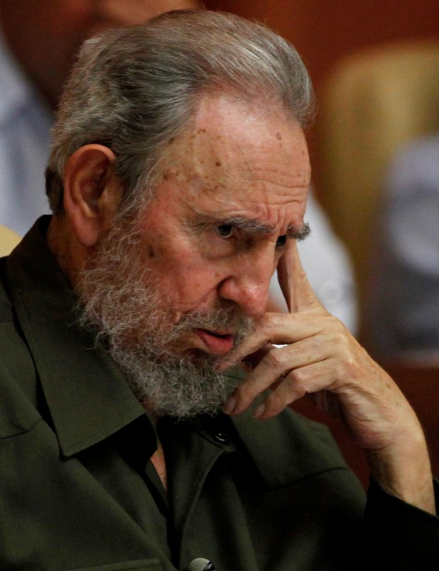 In this Aug. 7, 2010 file photo, Fidel Castro attends a special session of parliament in his first official government appearance in front of lawmakers in four years in Havana, Cuba. (