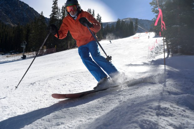 A skiers hugs the side of the High-Noon run on opening day at Arapahoe Basin ski area October 21, 2016.