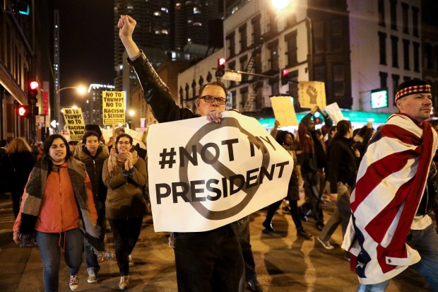 Protesters march North on State Street to express their disapproval of the election of Donald Trump as the 45th president of the United States, Nov. 9, 2016 in Chicago.