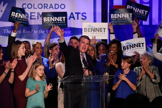US Democratic Senatorial incumbent Michael Bennet waves to supportes as he gives his acceptance speech after beating Republican rival Darryl Glenn in the US Senate race at the Denver Westin Downtown on November 8, 2016 in Denver, Colorado. The Colorado Democrats held their election night party in the ballroom at the hotel.