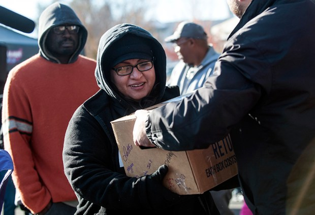 Families receive Thanksgiving meal boxes from the Epworth Foundation last Saturday in Denver.