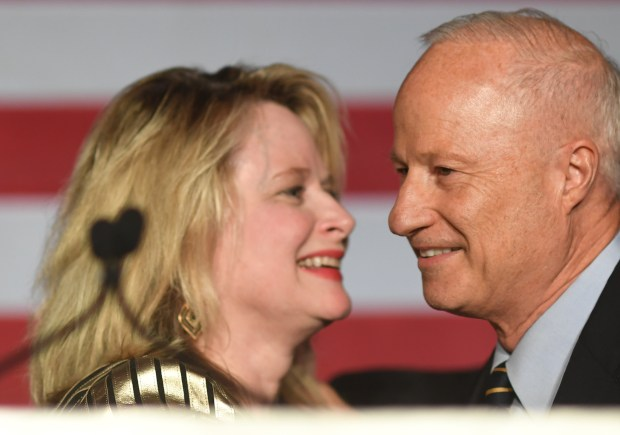 U.S. Rep. Mike Coffman, and his wife, Cynthia Coffman, takes the stage during the Colorado RepublicanÊElection Night party at the DoubleTree Hilton in the Denver Tech Center, November 08, 2016.