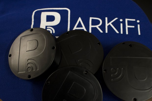 Numerous parking apps target Denver. One Denver startup, Parkifi, installs sensors in parking garages and lots so the owners of the lots can see what the capacity of the lots. Co-founders Ryan Sullivan and Rishi Malik show the sensor and app on the desktop April 9, 2015 at their office in downtown Denver. The sensors look like a hockey puck.