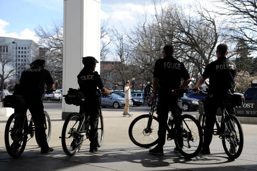 Officers with the Denver Police Department keep an eye on people as they leave the 420 Rally at Civic Center Park in Denver, Colorado on April 20, 2014.