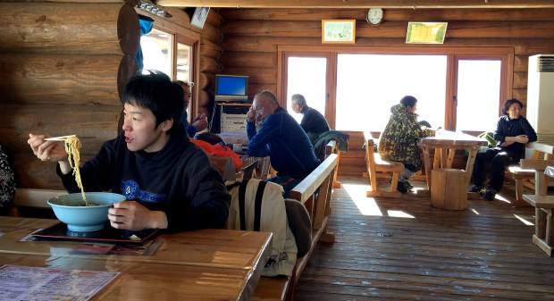Skiers and snowboarders take a lunch break at the lodge atop Charmant Hiuchi, a two-lift ski area near Itoigawa, Japan. Ramen adorned with fresh vegetables, meat and seafood is a staple on lunch menus throughout Japan's ski country.