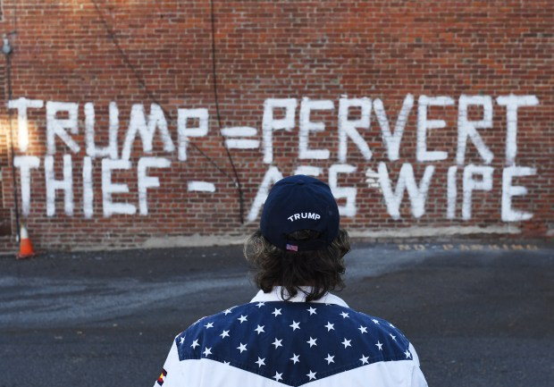 Stephen Barlock, Denver Co-Chair of the Trump Campaign Colorado, stands outside vandalism at the Trump Denver headquarters
