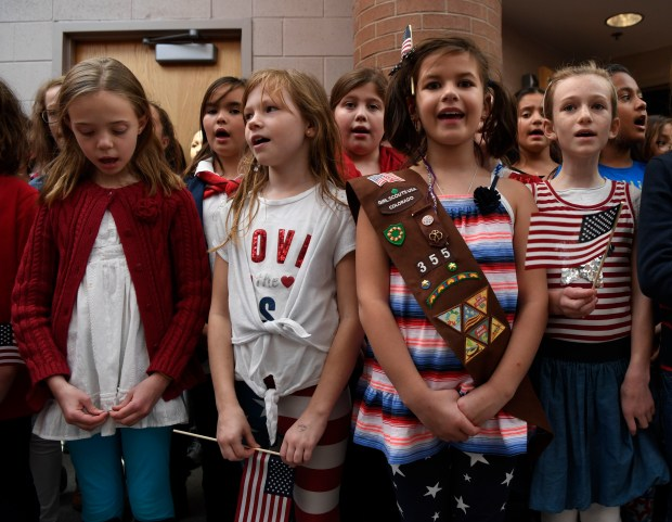 The Fox Hollow Elementary School choir sings the National Anthem and other patriot songs for Veterans gathered at the school Nov. 10, 2016.