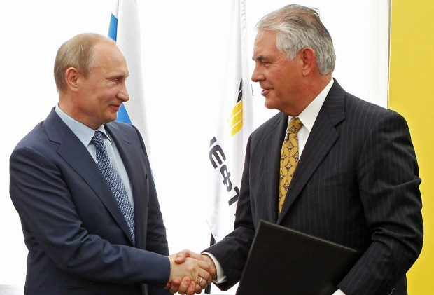 In this June 15, 2012, file photo, Russian President Vladimir Putin, left, and ExxonMobil CEO Rex Tillerson shake hands at a signing ceremony of an agreement between state-controlled Russian oil company Rosneft and ExxonMobil at the Black Sea port of Tuapse, southern Russia.