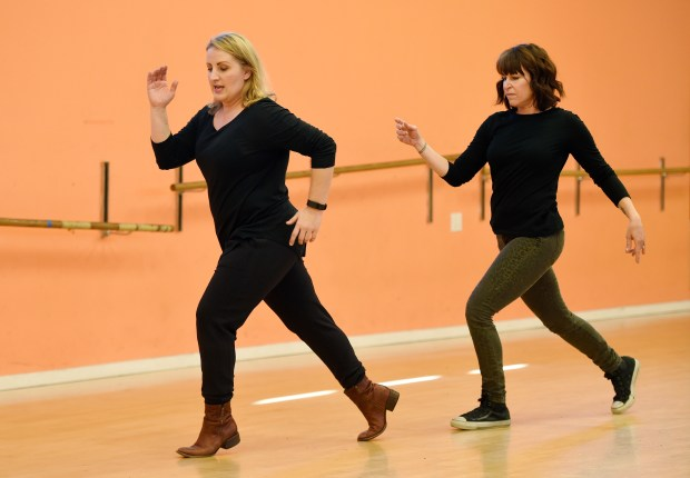 """In this Monday, Dec. 19, 2016 photo, Mandy Moore, left, choreographer for """"La La Land,"""" teaches dance moves from the film to Associated Press reporter Sandy Cohen at Screenland Studios in Los Angeles. Creating show-stopping numbers and Ryan Gosling and Emma Stone's celestial moves in """"La La Land"""" wasn't choreographer Moore's only role in the dreamy musical. She also spent months personally teaching the stars how to dance."""