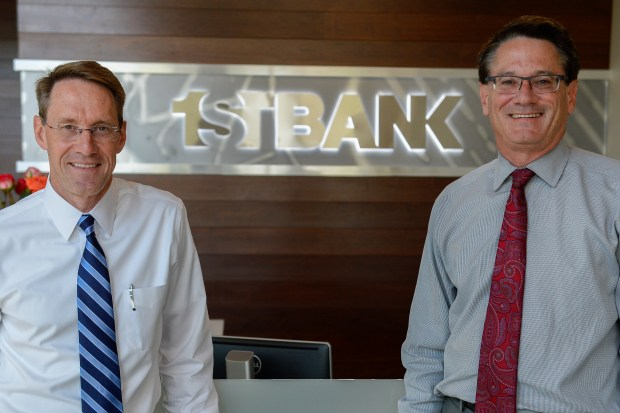 FirstBank chief operating officer Jim Reuter, left, has been named the Lakewood-based bank's new CEO with the retirement of John Ikard, not pictured, and president Dave Baker, right.