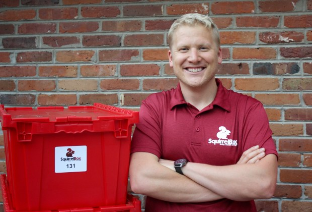 """Everything that fits in this red box will cost SquirrelBox customers $7 a month to store. Larger items, like snow tires, are $15 a month. Plus you don't even need to leave your house for this """"valet storage"""" service. Pictured is founder Cameron Smith."""