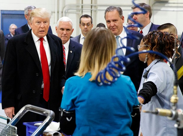 President-elect Donald Trump and Vice President-elect Mike Pence talk to workers during a visit to a Carrier factory Thursday in Indianapolis.
