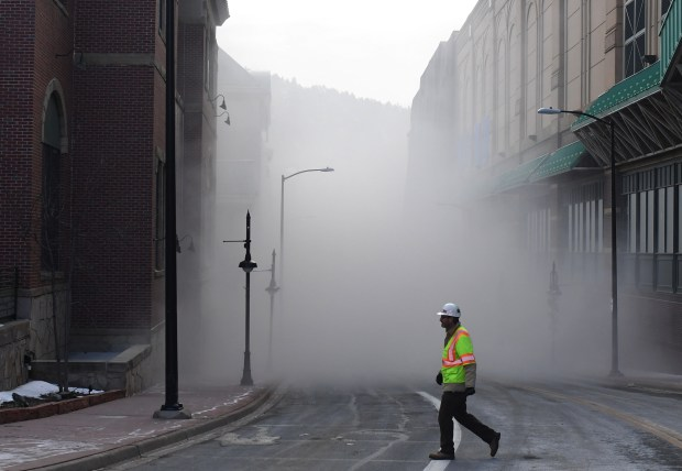 A crew member walks past a street that was closed as they brought down Monarch Casino Black Hawk's parking garage, December 21, 2016. The garage was brought down to make room for the casino's new hotel.