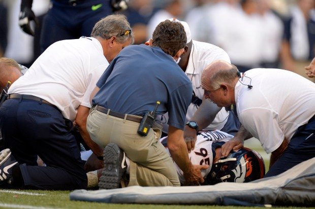 Derek Wolfe being tended to by trainers after spinal cord injury.