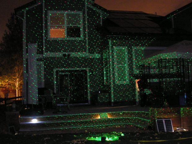 Christmas laser lights have the quickest installation for holiday lighting: Just put the staked lamp projector in the ground. This scene was created by the Quatro Laser Light from Golden-based Infinity Laser Lights. It's currently on sale for $145.