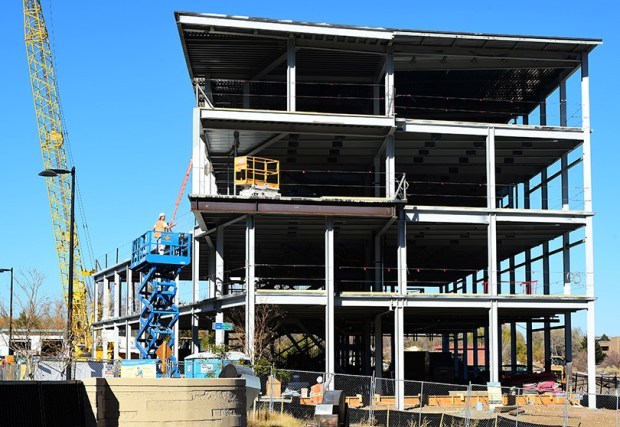 Construction crews work on a building project in Boulder in November. The Boulder Planning Board this week rejected an unrelated housing project that would have provided 50 middle-income housing units on the city's most active transit corridor.