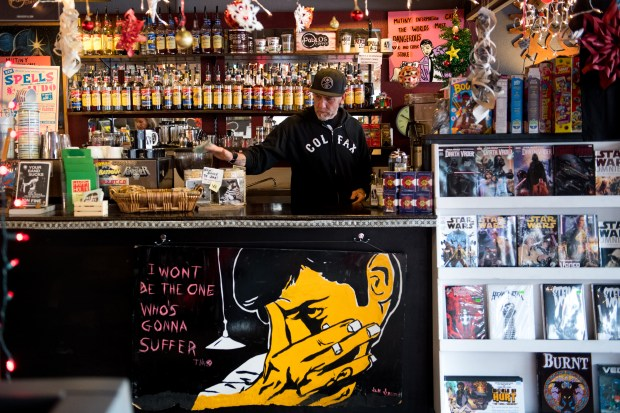 Owner Jim Norris works behind the coffee counter at Mutiny Information Cafe on December 2, 2016, in Denver, Colorado. Along with co-owner Matt Megyesi, Norris intends to apply for a social marijuana use permit once the city's Department of Excise and Licenses works out the particulars of how to implement Initiative 300.