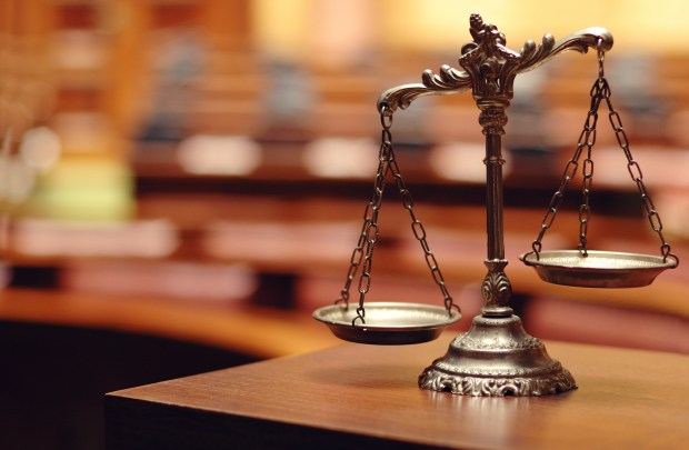 """""""Symbol of law and justice in the empty courtroom, law and justice concept."""""""
