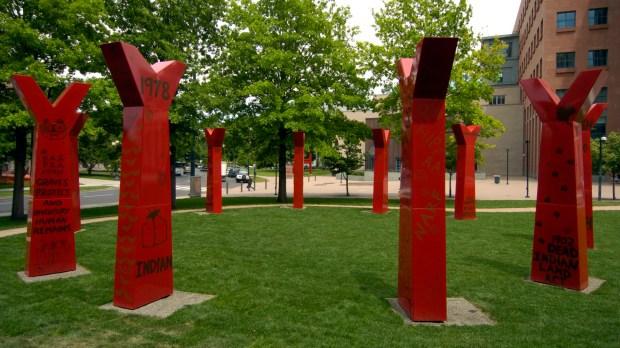 "Edgar Heap of Birds' ""Wheel"" sculpture stands just outside the entrance of the Denver Art Museum."