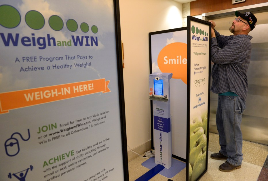 PARKER, CO - DECEMBER 19: Technician Bobby Butler finishes the installation of the Weigh and Win kiosk at Parker Adventist Hospital. Parker Adventist Hospital has a new Weigh and Win kiosk in the garden level lobby, courtesy of parent company Centura Health. The automated kiosk allows visitors to input their own information and received free health and weight loss coaching as well as making them eligible for cash rewards for healthier living.(Photo by Kathryn Scott/The Denver Post )