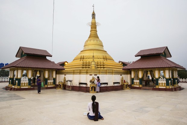 A worshiper prays at a small pagoda in Naypyidaw, Myanmar, on March 9, 2016.