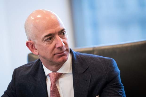 Jeff Bezos, chief executive officer of Amazon, listens during a meeting of technology executives and President-elect Donald Trump at Trump Tower, December 14, 2016 in New York City.