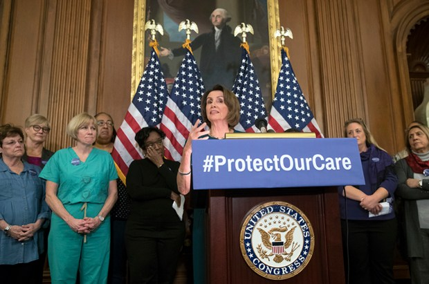 House Minority Leader Nancy Pelosi is joined by nurses from around the country during a press conference on Wednesday to urge protection of patients' rights under the Affordable Care Act.