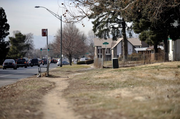 This bus stop near Madison Street and Martin Luther King Boulevard has no sidewalk. Denver leaves the responsibility and liability to adjacent property owners for maintaining and building sidewalks, which has many neighborhoods lacking consistent walkways.