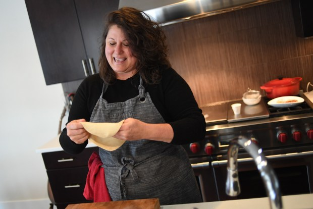 Chef Elise Wiggins makes focaccia di recco with cresza cheese at her home in Denver, January 05, 2017.