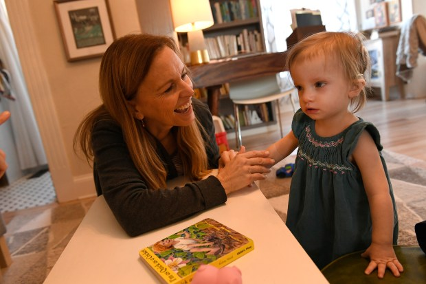 American Sign Language teacher Lori Fisk, left, works with 19 month old Anna, right, during a tutoring session at Anna's home on January 26, 2017 in Wheat Ridge, Colorado. Anna was born profoundly deaf as a result of an infection from CMV, a common virus that pregnant women are often under-educated about. It is estimated that, in reality, 20,000 to 40,000 babies in America are born with congenital CMV each year but aren't diagnosed because they appear healthy at birth or doctors mistake their symptoms for other diseases. Anna contracted CMV in-utero from her mother Megan not because the family traveled to another country, but because they have a toddler. CMV is spread most often through the saliva and urine of children under the age of 3 in some studies, it is present in 44 to 100% of toddlers at daycare centers, and they will go on to shed it for two years or longer.