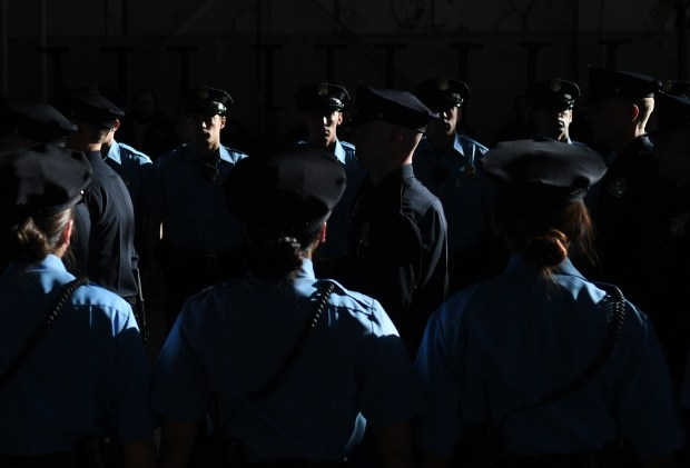 Police Recruits walk in for their graduation at Denver Police Academy training facility, January 06, 2017. A Denver fire arson investigator and 32 officers in training were sworn in during the ceremony.
